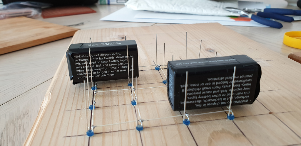 9V Batteries Holding The Layers Apart